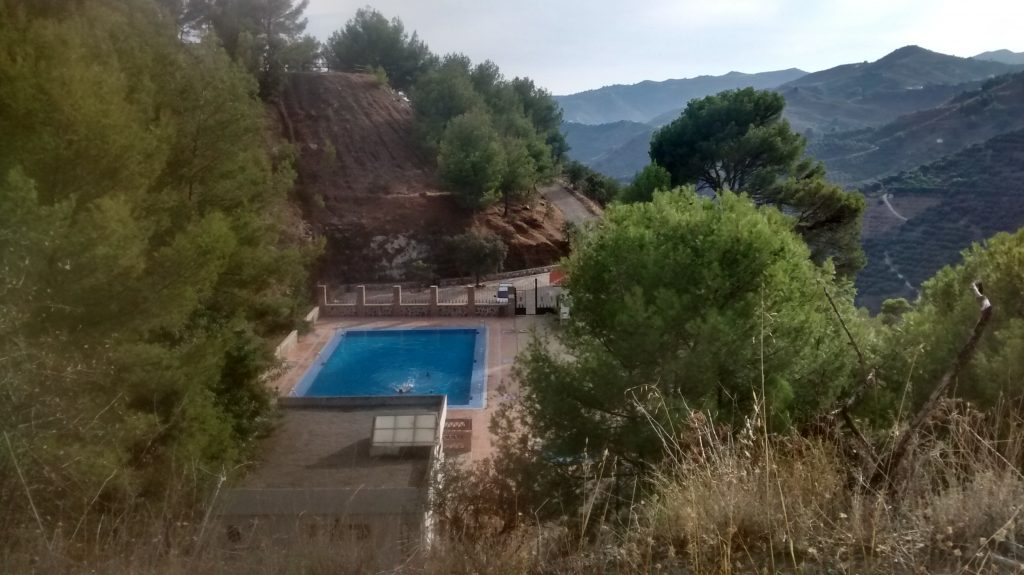 The swimming pool of Jete, in the hills of the green valley, South Granada province